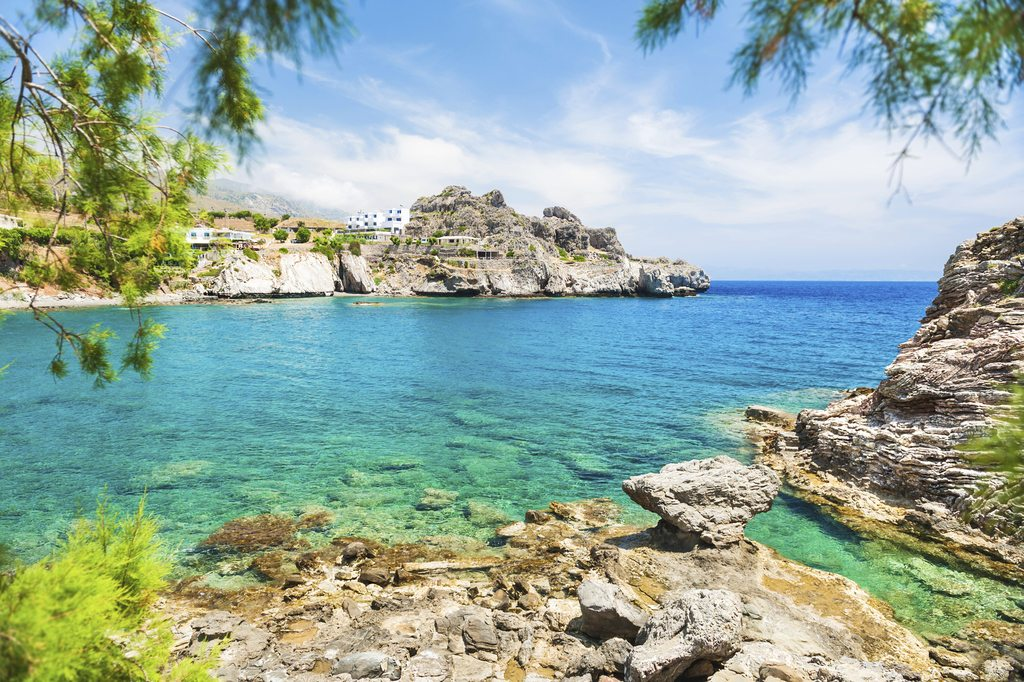 Beautiful beach with turquoise water and cliffs. Selective focus. Crete island, Greece.